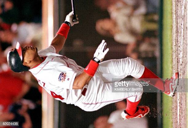 Cleveland Indians right fielder Manny Ramirez watches the ball bounce off the center wall to give him a two-RBI double in the third inning of game...