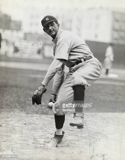 Cleveland Indian's right fielder Shoeless Joe Jackson pitching in baseball game