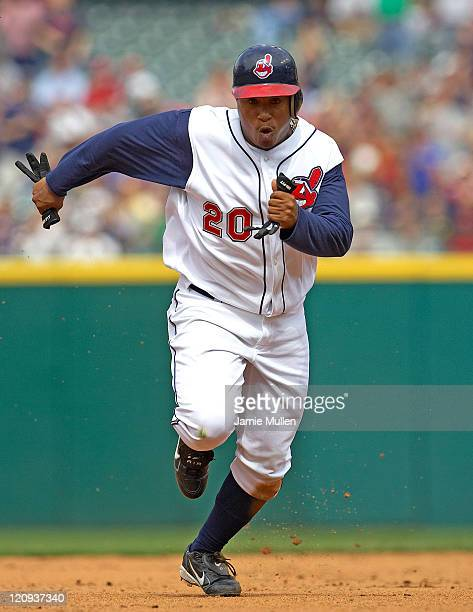 Cleveland Indians' Ronnie Belliard heads to third base after a throwing error by Minnesota third baseman Michael Cuddyer during the game Sunday April...