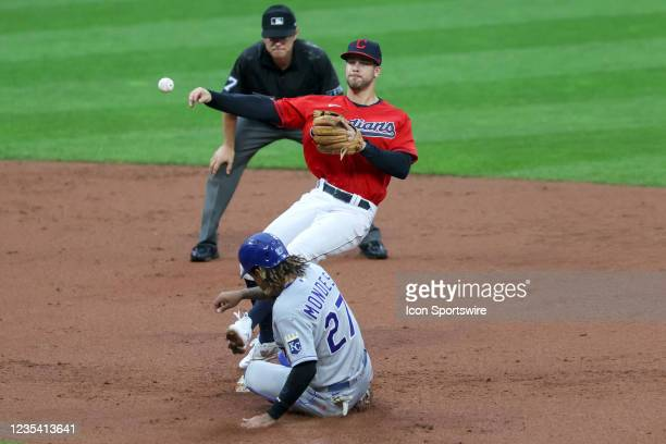 Cleveland Indians second base Ernie Clement throws to first base to complete a double play after forcing out Kansas City Royals pitcher Mike Minor at...