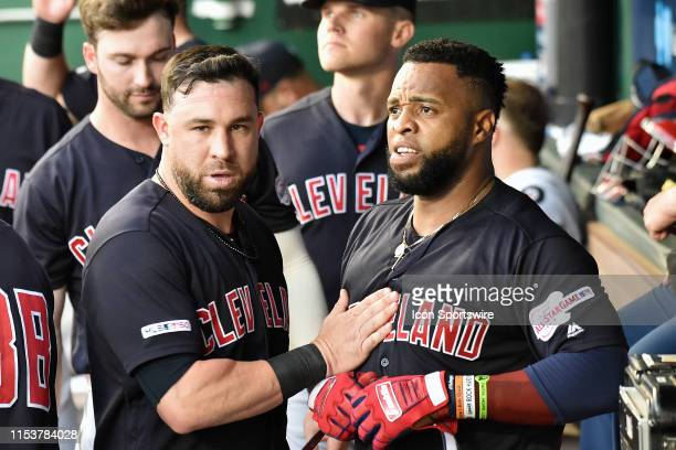 Cleveland Indians second baseman Jason Kipnis and Cleveland Indians first baseman Carlos Santana in the dugout after a solo home run by Santana...