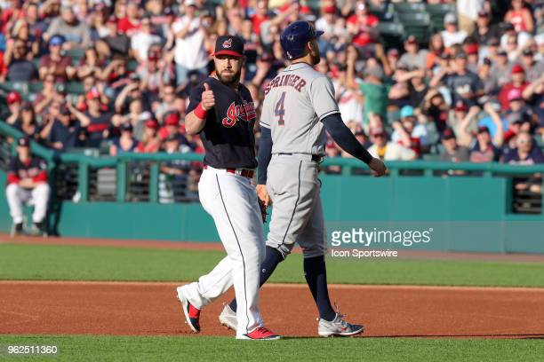 Cleveland Indians second baseman Jason Kipnis gives a thumbsup sign after tagging out Houston Astros center fielder George Springer attempting to...