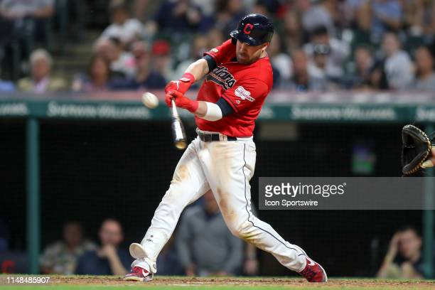 Cleveland Indians second baseman Jason Kipnis hits a sacrifice fly to score Cleveland Indians shortstop Francisco Lindor during the eighth inning of...