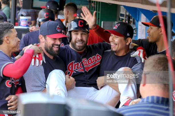 Cleveland Indians second baseman Jason Kipnis is carried thru the dugout by Cleveland Indians pitcher Adam Plutko and Cleveland Indians starting...