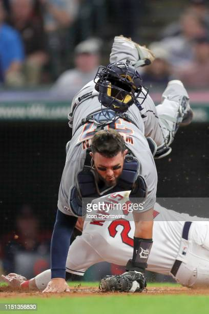 Cleveland Indians second baseman Jason Kipnis takes out Detroit Tigers catcher Bobby Wilson as he scores the eventual game-winning run on a sacrifice...
