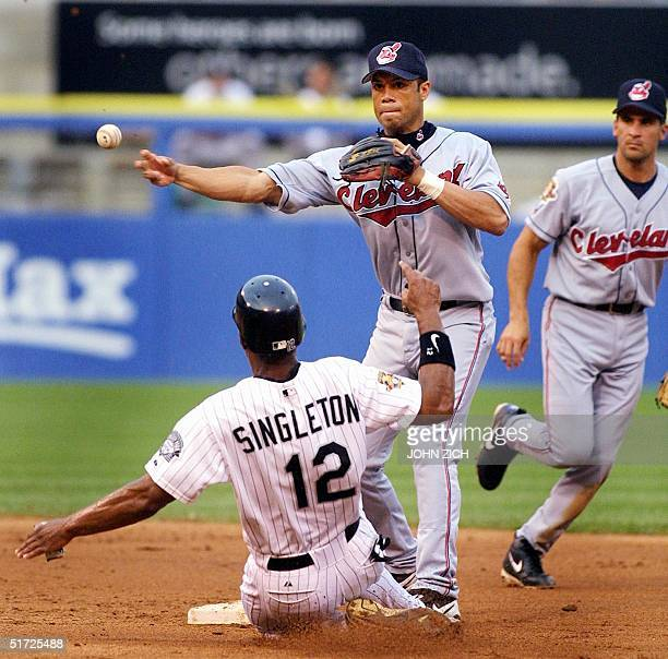 Cleveland Indians' second baseman Roberto Alomar turns a double play on the Chicago White Sox' Chris Singleton at second base in the first inning 19...