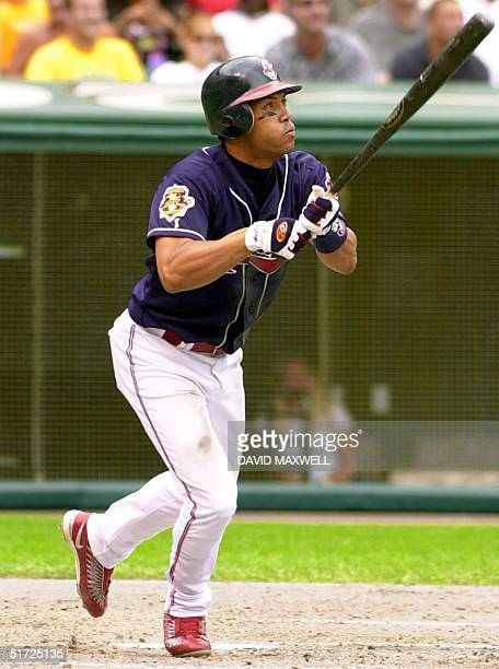 Cleveland Indians second baseman Roberto Alomar watches his home run off of St Louis Cardinals pitcher Andy Benes in the third inning 07 July 2001 at...