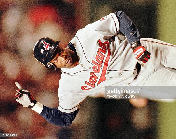 Cleveland Indians second baseman Tony Fernandez holds his finger in the air as he rounds third base after hitting a home run in the 11th inning to...