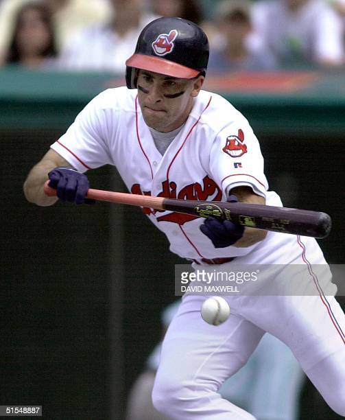 Cleveland Indians' short stop Omar Vizquel lays down a bunt single to lead off the fifth inning against the Cincinnati Reds 10 June, 2000 at Jacobs...