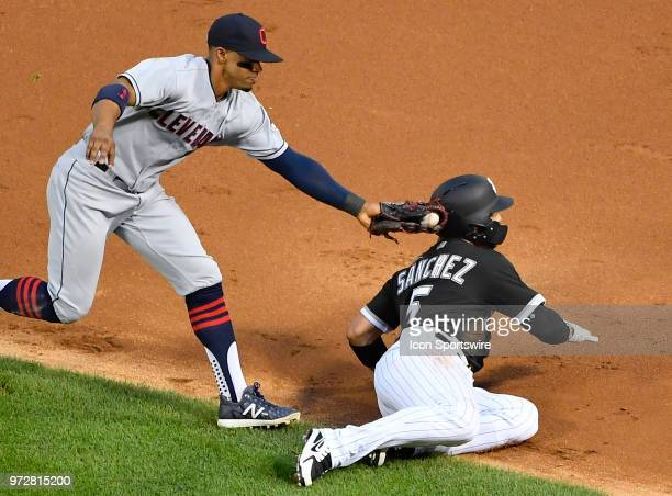Cleveland Indians shortstop Francisco Lindor appears to tag out Chicago White Sox second baseman Yolmer Sanchez but he advances to second base on a...