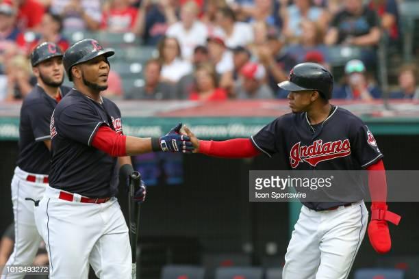 Cleveland Indians shortstop Francisco Lindor congratulates Cleveland Indians designated hitter Edwin Encarnacion after Lindor scored on a sacrifice...