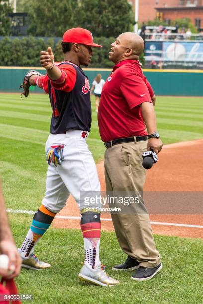 Cleveland Indians shortstop Francisco Lindor gives SportsTime Ohio sideline reporter Andre Knott a chest bump prior to the Major League Baseball game...