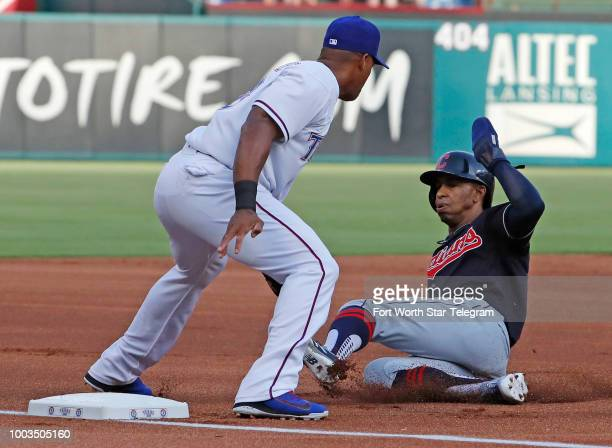 Cleveland Indians shortstop Francisco Lindor is out at third base top of the first inning with Texas Rangers third baseman Adrian Beltre making the...