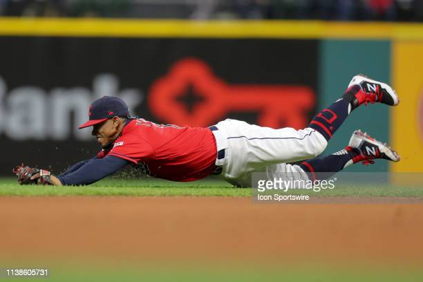 Cleveland Indians shortstop Francisco Lindor makes a diving stop during the sixth inning of the Major League Baseball interleague game between the...