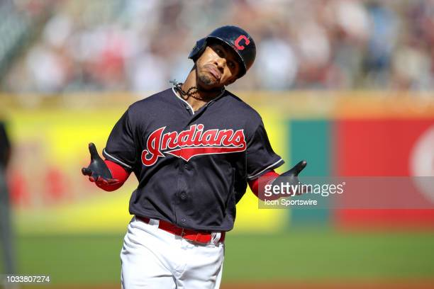 Cleveland Indians shortstop Francisco Lindor motions to the Indians dugout as he rounds the bases after hitting a home run during the first inning of...