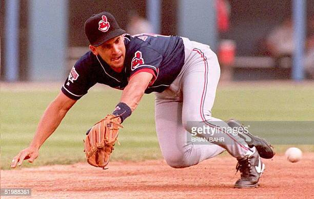 Cleveland Indians shortstop Omar Vizquel dives to catch a bouncing ball hit by Chicago White Sox batter Ray Durham in the second inning of their...