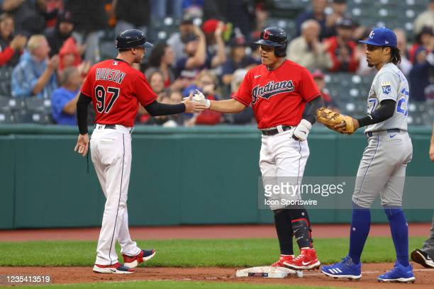 Cleveland Indians shortstop Yu Chang is congratulated by Cleveland Indians third base coach Kyle Hudson after hitting a bases loaded triple during...