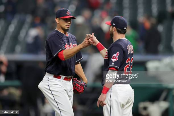Cleveland Indians starting pitcher Carlos Carrasco and Cleveland Indians second baseman Jason Kipnis celebrate following the Major League Baseball...