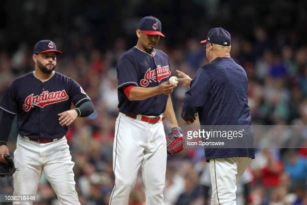 Cleveland Indians starting pitcher Carlos Carrasco hands the baseball to Cleveland Indians manager Terry Francona as he leaves the game during the...