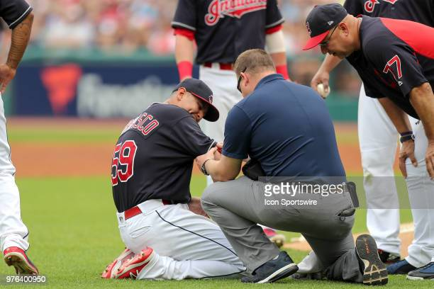 Cleveland Indians starting pitcher Carlos Carrasco is examined by a member of the Indians training staff as Cleveland Indians manager Terry Francona...