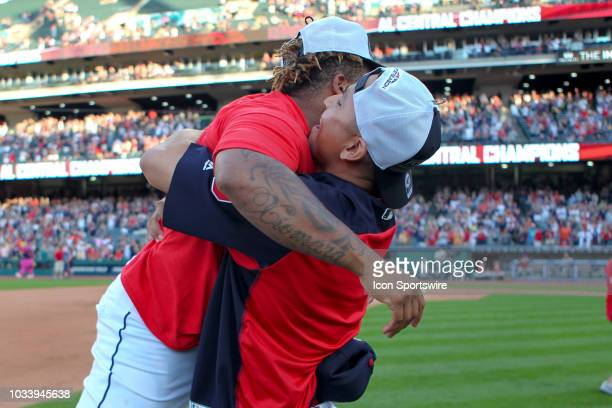 Cleveland Indians starting pitcher Carlos Carrasco lifts Cleveland Indians second baseman Jose Ramirez as they celebrate following the Major League...