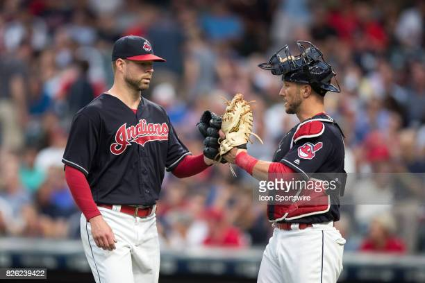 Cleveland Indians starting pitcher Corey Kluber and Cleveland Indians catcher Yan Gomes tap gloves following the fourth inning of the Major League...