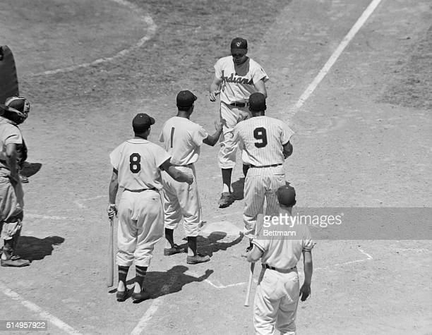 Cleveland Indians third baseman Al Rosen for a day a member of the American League All Stars is greeted at home plate after hoisting his first homer...
