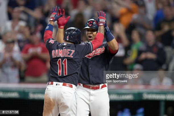 Cleveland Indians third baseman Jose Ramirez is greeted at home plate be Cleveland Indians designated hitter Edwin Encarnacion after hitting a 2 run...