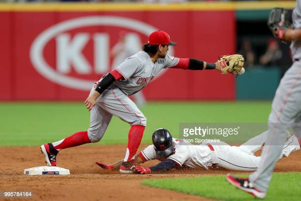 Cleveland Indians third baseman Jose Ramirez slides into second base with a double as Cincinnati Reds infielder Alex Blandino takes the throw during...
