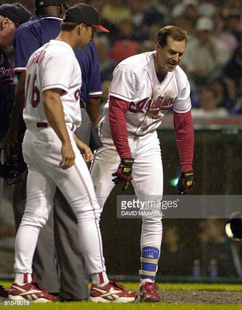 Cleveland Indians third baseman Travis Fryman throws his helmet in frustration after a disagreement with home plate umpire Chuck Meriwether 12 June...