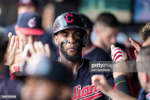 Cleveland Indians third baseman Yandy Diaz high fives in the dugout after scoring a run during the sixth inning of the Major League Baseball game...