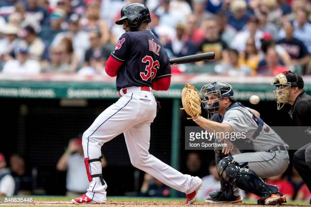 Cleveland Indians third baseman Yandy Diaz takes a pitch that Detroit Tigers catcher John Hicks misses and hits home plate umpire Quinn Wolcott...