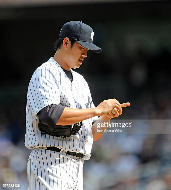 Cleveland Indians Vs New York Yankees at Yankee Stadium NY Yankees starting pitcher ChienMing Wang stands on the mound dejected in the second inning