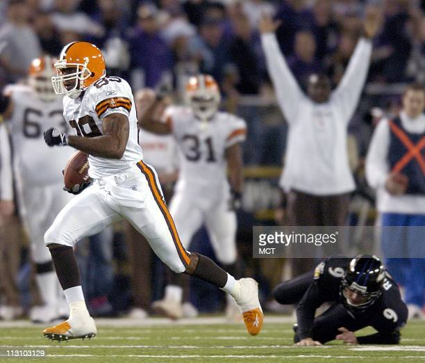 Cleveland kick returner Richard Alston runs past Baltimore kicker Wade Richey as he returns the opening kickoff for a touchdown during the Browns...