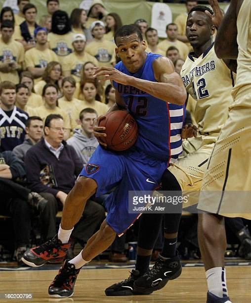 Cleveland Melvin of the DePaul Blue Demons handles the ball against the Pittsburgh Panthers at Petersen Events Center on January 26, 2013 in...