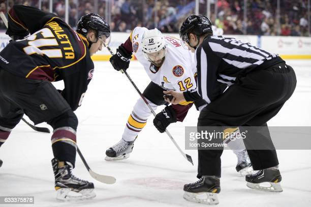 Cleveland Monsters C Jordan Maletta and Chicago Wolves C Wade Megan prepare to faceoff during the second period of the AHL hockey game between the...