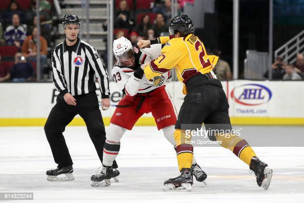 Cleveland Monsters center Calvin Thurkauf and Grand Rapids Griffins center Dominic Turgeon fight during the second period of the American Hockey...