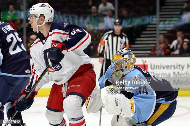 Cleveland Monsters center Jordan Maletta screens Milwaukee Admirals goalie Juuse Saros vision of the puck during the second period of the American...