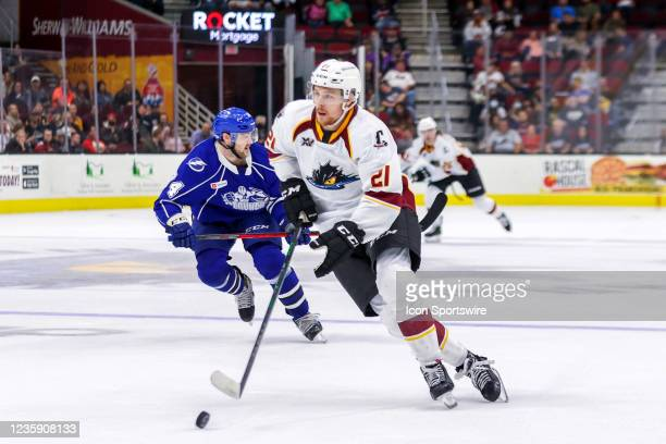 Cleveland Monsters center Josh Dunne plays the puck during the third period of the American Hockey League game between the Syracuse Crunch and...