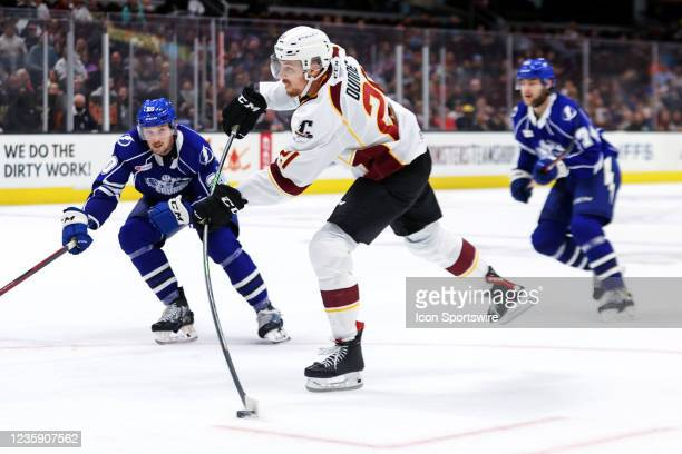 Cleveland Monsters center Josh Dunne shoots during the third period of the American Hockey League game between the Syracuse Crunch and Cleveland...