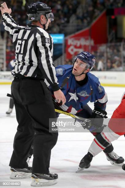 Cleveland Monsters center Justin Scott looks up at linesman James Tobias after being removed from a faceoff during the second period of the American...
