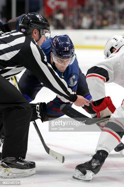 Cleveland Monsters center Justin Scott prepares to take a faceoff during the second period of the American Hockey League game between the Grand...