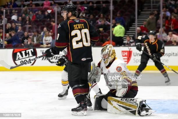 Cleveland Monsters center Justin Scott screens Chicago Wolves goalie Zachary Fucale during the second period of the American Hockey League game...