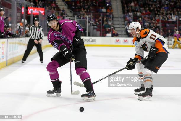 Cleveland Monsters center Kevin Stenlund passes the puck as Cleveland Monsters center Kevin Stenlund controls the puck as Lehigh Valley Phantoms...