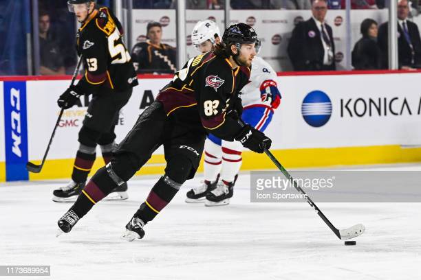 Cleveland Monsters center Kevin Stenlund skates away with the puck during the Cleveland Monsters versus the Laval Rocket game on October 04 at Place...