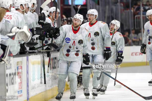 Cleveland Monsters center Mark Letestu is congratulated by teammates after scoring a goal during the second period of the American Hockey League game...