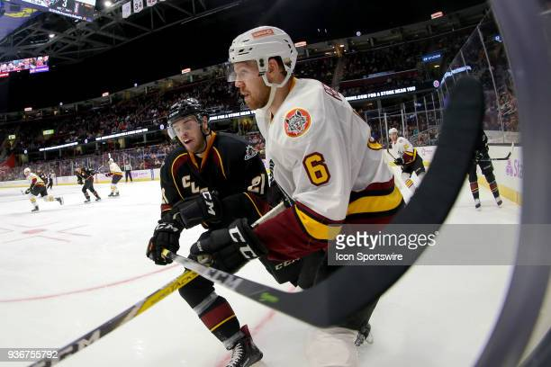 Cleveland Monsters center Sam Vigneault battles Chicago Wolves defenceman Griffin Reinhart in the corner during the second period of the American...