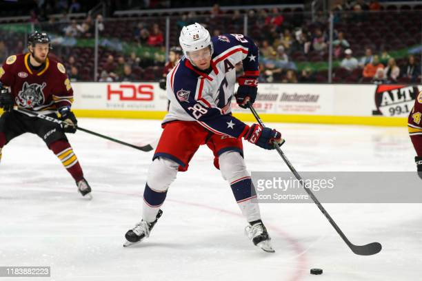 Cleveland Monsters center Zac Dalpe controls the puck during the second period of the American Hockey League game between the Chicago Wolves and...