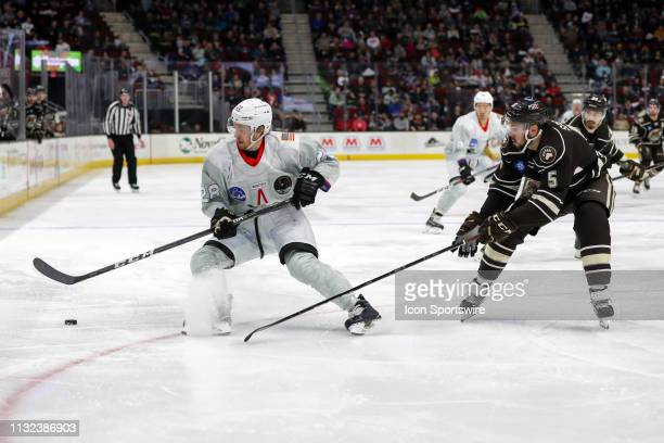 Cleveland Monsters center Zac Dalpe plays the puck as Hershey Bears defenceman Ryan Sproul defends during the second period of the American Hockey...