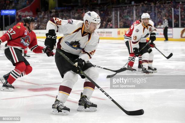 Cleveland Monsters D Cameron Gaunce plays the puck during the second period of the AHL hockey game between the Rockford IceHogs and Cleveland...